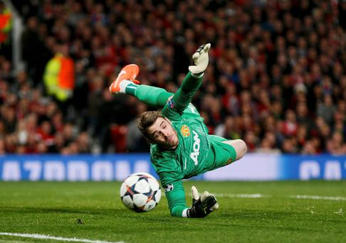 Manchester United's David de Gea makes a save during their Champions League quarter-final first leg soccer match against Bayern Munich at Old Trafford in Manchester, April 1, 2014. REUTERS/Stefan Wermuth (BRITAIN - Tags: SPORT SOCCER)