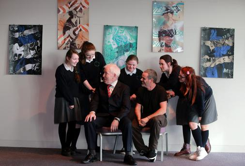 Arts Minister Jimmy Deenihan and Fin Dac, the new Artist in Residence at the Gibson Hotel, with, from left, Leah Maher, Jasmine Delaney, Niamh Faulkner, Eire Greene and Nicola Byrne, all second-year students at Ringsend Community College. Picture: ARTHUR CARRON