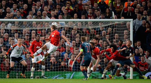 Nemanja Vidic heads in the first goal during the Champions League tie wit FC Bayern Muenchen.