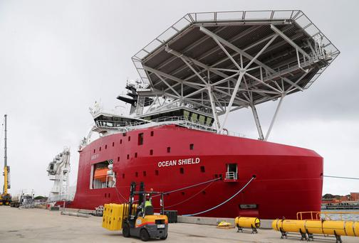 Australian Defense ship Ocean Shield is docked at naval base HMAS Stirling while being fitted with an autonomous underwater vehicle (AUV) and towed pinger locator to aid in the search for missing Malaysia Airlines Flight MH370