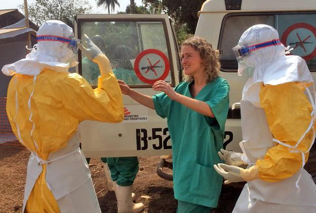 Healthcare workers from the organisation, react, as they prepare isolation and treatment areas for their Ebola, hemorrhagic fever operations, in Gueckedou, Guinea