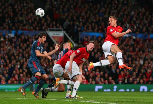 Nemanja Vidic heads home Manchester United's goal during last night's 1-1 draw with Bayern Munich at Old Trafford