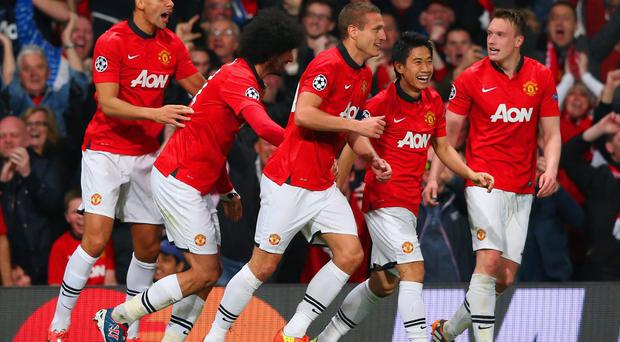 Nemanja Vidic celebrates with his Manchester United team-mates after scoring their first goal