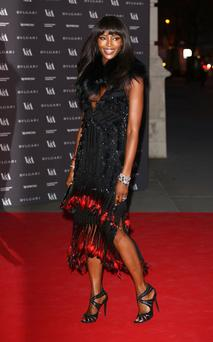 Naomi Campbell attends the preview of The Glamour of Italian Fashion exhibition at Victoria & Albert Museum on April 1, 2014 in London, England. (Photo by Tim P. Whitby/Getty Images)