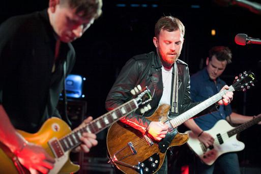 Matthew Followill, Caleb Followill and Jared Followill of The Kings of Leon (Photo by Gabriel Olsen/WireImage)