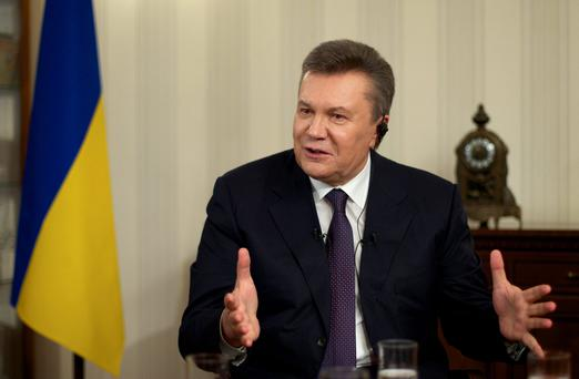 Ousted Ukrainian President Viktor Yanukovych gestures during an interview with The Associated Press, in Rostov-on-Don, Russia, Wednesday, April 2, 2014. Yanukovych says the annexation of Crimea was a tragedy and he would have done everything possible to prevent it, had he remained in power. (AP Photo/Ivan Sekretarev)
