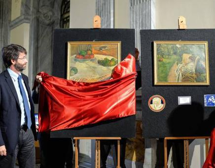 Italian minister of culture Dario Franceschini and General of Carabinieri Mariano Mossa unveil the two paintings stolen in London in the 1970s by French artists Paul Gauguin (left) and Pierre Bonnard (right)