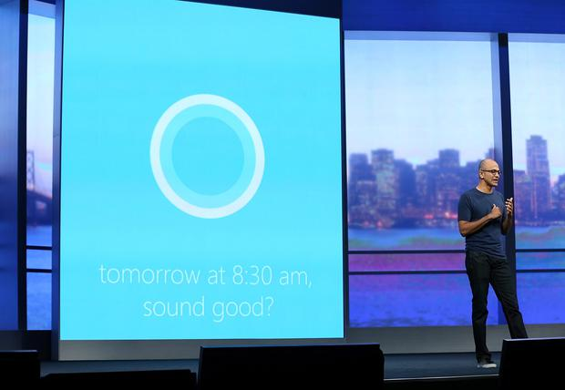Microsoft CEO Satya Nadella demonstrates Cortana, a new digital personal assistant function for Windows phones (Photo by Justin Sullivan/Getty Images)