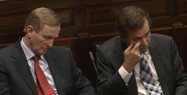 An Taoiseach Enda Kenny and Minister for Justice Alan Shatter watches on during a vote of confidence on his ministerial position this evening.