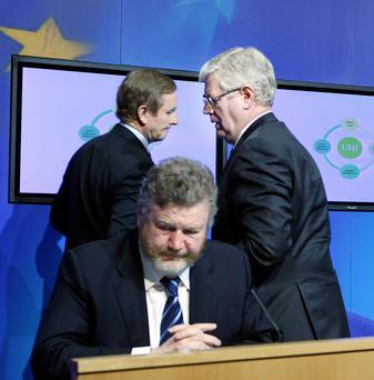 Taoiseach Enda Kenny, Tanaiste Eamon Gilmore and Health Minister Dr James Reilly at the launch of the white paper on UHI. Photo: Tom Burke