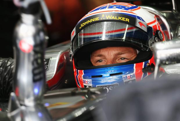 KUALA LUMPUR, MALAYSIA - MARCH 28: Jenson Button of Great Britain and McLaren prepares to drive during practice for the Malaysia Formula One Grand Prix at the Sepang Circuit on March 28, 2014 in Kuala Lumpur, Malaysia. (Photo by Mark Thompson/Getty Images)
