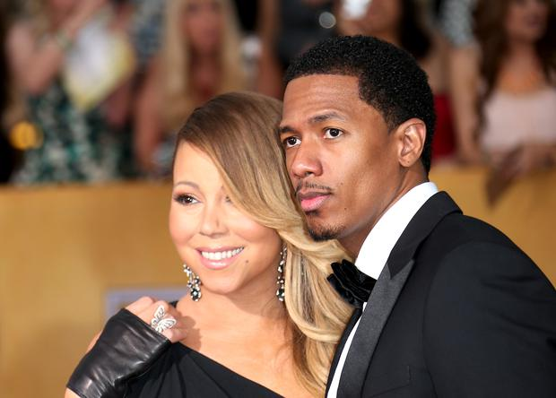 Mariah Carey and Nick Cannon (R) arrive at the 20th Annual Screen Actors Guild Awards