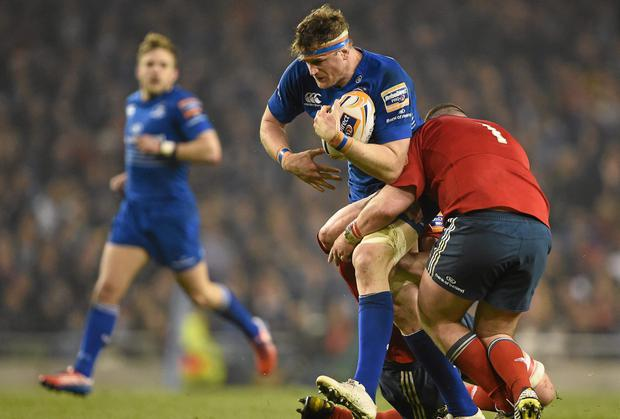 Munster pair Dave Kilcoyne and Dave Foley get to grips with Jamie Heaslip during the game against Leinster at the Aviva last weekend