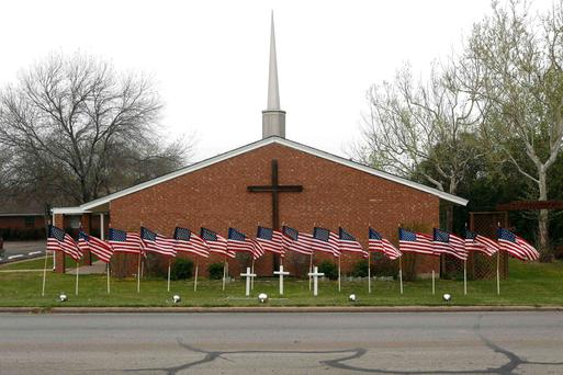 U.S. flags are pictured in front of the Central Christian Church in Killeen, Texas April 3, 2014, where the Fort Hood Army Base is located.