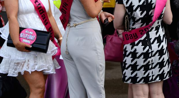 Racegoers attend Day 2, Ladies Day, of the Aintree races at Aintree Racecourse on April 4, 2014 in Liverpool, England. (Photo by Richard Martin-Roberts/Getty Images)