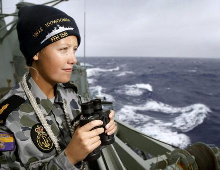 Able Seaman Boatswains Mate Stephanie Went of HMAS Toowoomba searches for missing Malaysia Airlines flight MH370 in the southern Indian Ocean. Pic credit: Getty