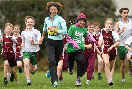 Sonia O'Sullivan and her daughter Sophie (in pink hat) with Children from Saint Brigid's National School