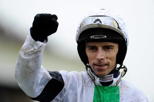 Leighton Aspell riding Pineau De Re win The Crabbie's Grand National Steeple Chase at Aintree racecourse