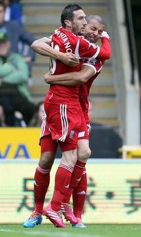 West Bromwich Albion's Morgan Amalfitano (left) is congratulated by team mate Steve Reid after scoring the winner