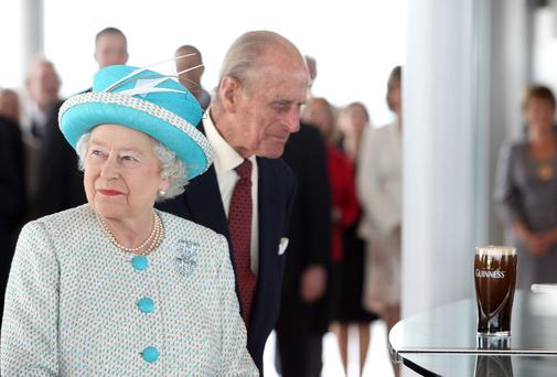 Queen Elizabeth II and The Duke of Edinburgh pictured receiving a pint of Guinness at the Guinness Storehouse on their state visit to Ireland. Picture: Maxwells