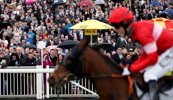 Comparisons can be drawn between the current political jockeying for position and the recent racing at the Grand National meeting at Aintree. Photos: REUTERS/Russell Cheyne