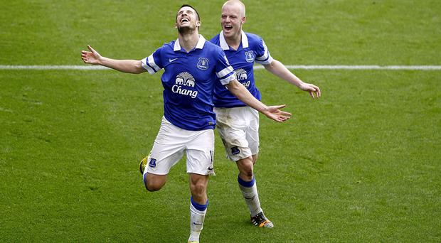 Everton's Kevin Mirallas celebrates his side's third goal with Steven Naismith