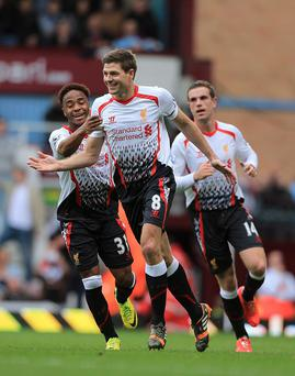 Liverpool's Steven Gerrard (centre) celebrates after scoring his team's opening goal