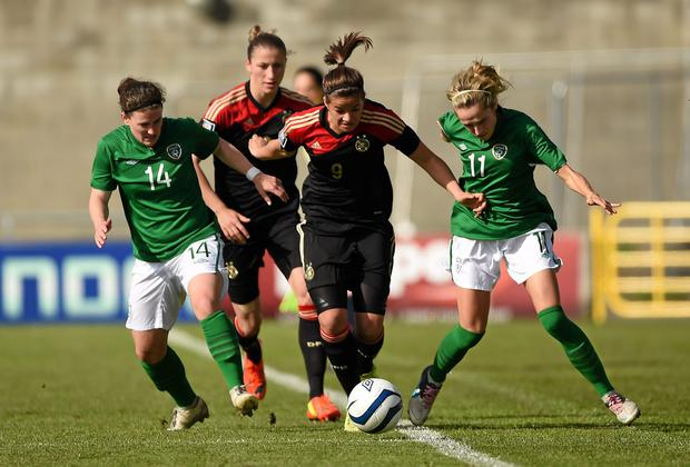 Lena Lotzen, Germany, in action against Shannon Smyth, left, and Julie Ann Russell, Republic of Ireland