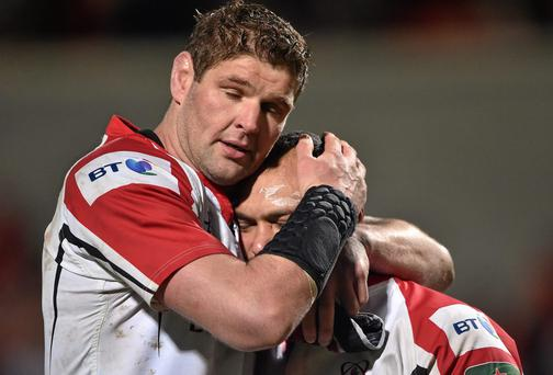 Ulster captain Johann Muller consoles John Afoa after the game
