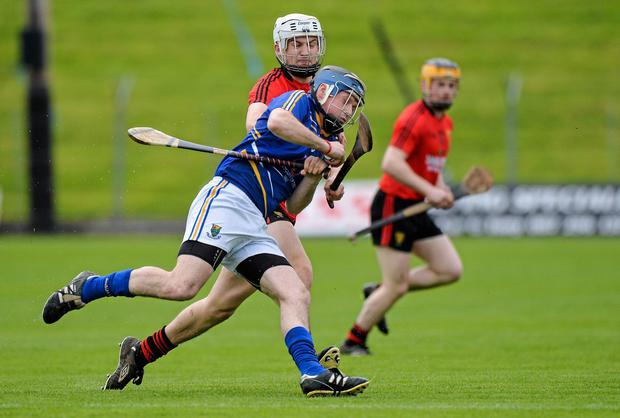 Gary Byrne, Wicklow, in action against Donal Hughes, Down