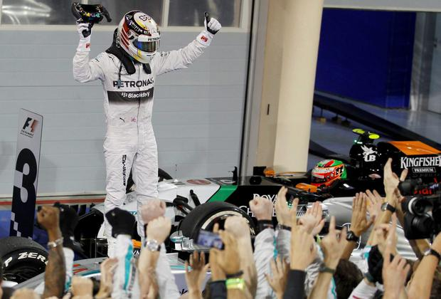 Mercedes Formula One driver Lewis Hamilton of Britain celebrates after winning the Bahrain F1 Grand Prix at the Bahrain International Circuit (BIC) in Sakhir, south of Manama