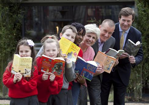 Julian Yarr, managing partner, A&L Goodbody; Martin Tomlinson, CEO of Suas; Adelaide Nic Charthaigh, Literacy Support Programme Manager, Suas; with Kimberlee Bazunu, aged 10; Ross Egan, aged 10; Abbie Butler, aged 9, and Zoe Duffy, aged 10. Picture: Shane O'Neill / Fennells