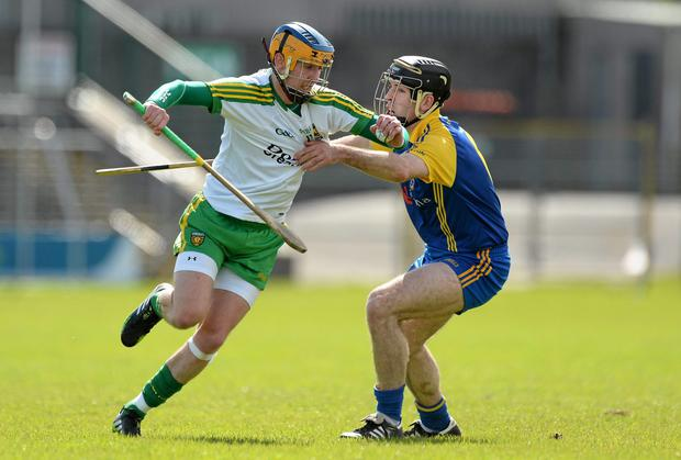 Donegal's Enda McDermott clashes with Roscommon's Michael Kellyduring their Allianz NHL Division 3A final at Markievicz Park