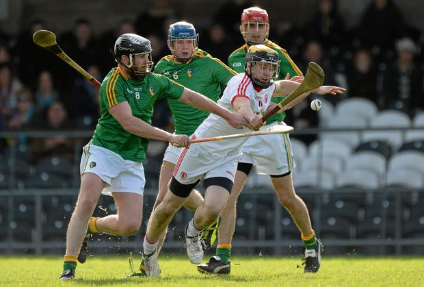 Tyrone's Conor Grogan in action against Leitrim's Clement Cunniffe, David McGovern and Michael Poniard