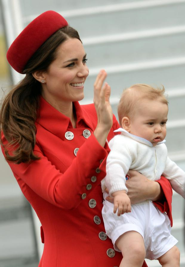 The Duke and Duchess of Cambridge arrive with Prince George at Wellington Military Terminal on the first day of their official to Australia