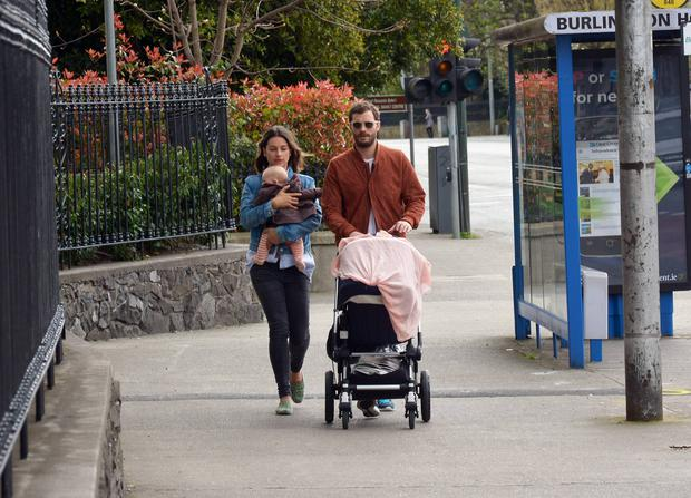 Fifty Shades of Grey actor Jamie Dornan takes a stroll with his wife Amelia Warner and their baby daughter to get the Sunday papers the morning after winning two IFTA awards, DoubleTree by Hilton Dublin Hotel
