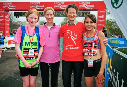 Catherina McKiernan, second left, with her daughter Deirbhile, far left, who placed third in the Junior Great Ireland Run, beside Sonia OSullivan with her daughter Sophie who won the Junior Great Ireland Run. Photo: Tomás Greally / SPORTSFILE