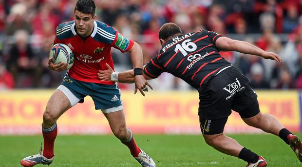 Conor Murray, Munster, is tackled by Jaba Bregvadze, Toulouse