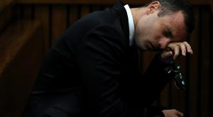 Oscar Pistorius gestures as he listens to evidence by a pathologist during his murder trial in Pretoria. Photo: Reuters.