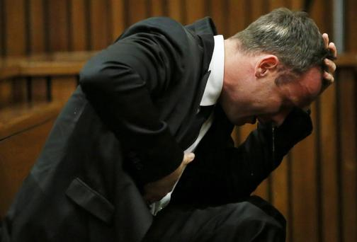 Oscar Pistorius becomes emotional during his trial at the high court in Pretoria. Picture: REUTERS/Themba Hadebe/Pool