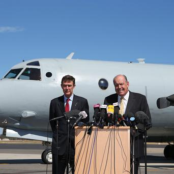 Australian Air Chief Marshal Angus Houston (Ret'd) and Defence Minister David Johnston address the media during a press conference over the continuing search for missing Malaysia Airlines Flight MH370 at RAAF Base Pearce on April 8, 2014 in Perth, Australia.