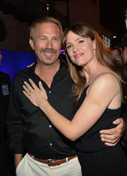 Actor Kevin Costner, left, and actress Jennifer Garner attend the after party for Summit Entertainment's