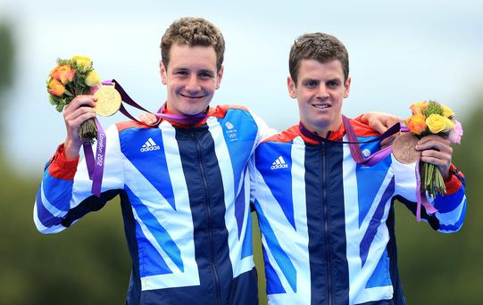 The Brownlee brothers: Alistair Brownlee celebrates with his gold medal and Jonathan Brownlee (right) celebrates with his bronze medal, after the Men's Triathlon on the eleventh day of the London 2012 Olympics.
