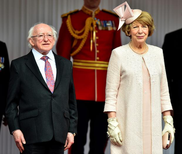 WINDSOR, ENGLAND - APRIL 08: Irish President Michael D. Higgins (L) stands with his wife Sabrina Higgins during a ceremonial welcome at Windsor Castle on April 8, 2014 in England. This is the first official visit by the head of state of the Irish Republic to the United Kingdom. (Photo by Ben Stansall - WPA Pool/Getty Images)