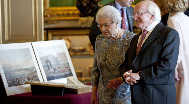 President Higgins with Queen Elizabeth viewing a display of Irish Items from the Royal Collection in the Green Drawing Room in Windsor Castle