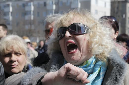 A Pro-Russian activist shouts during a rally in front of the regional administration building in Donetsk, Ukraine, Tuesday, April 8, 2014 (AP Photo/Efrem Lukatsky)