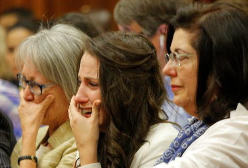 Sister of Oscar Pistorius, Aimee Pistorius, second from right, cries as she listens as her brother testifies in court in Pretoria, South Africa, yesterday