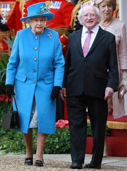 Queen Elizabeth II walks with President of Ireland Michael D Higgins and Sabrina Higgins at Windsor Castle after a ceremonial welcome on April 8, 2014 in England. This is the first official visit by the head of state of the Irish Republic to the United Kingdom. (Photo by Peter Macdiarmid/Getty Images)