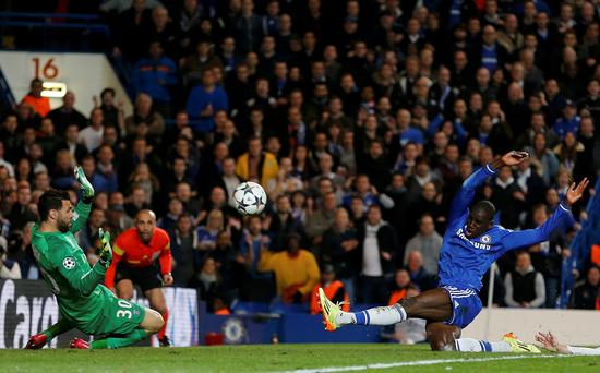 Paris St Germain's goalkeeper Salvatore Sirigu fails to catch the ball as Chelsea's Demba Ba scores the crucial second goal for Chelsea.
