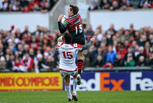 Alex Goode, Saracens, is tackled by Jared Payne, Ulster, early in the first half. The tackle was deemed dangerous and Jared Payne was shown a red card